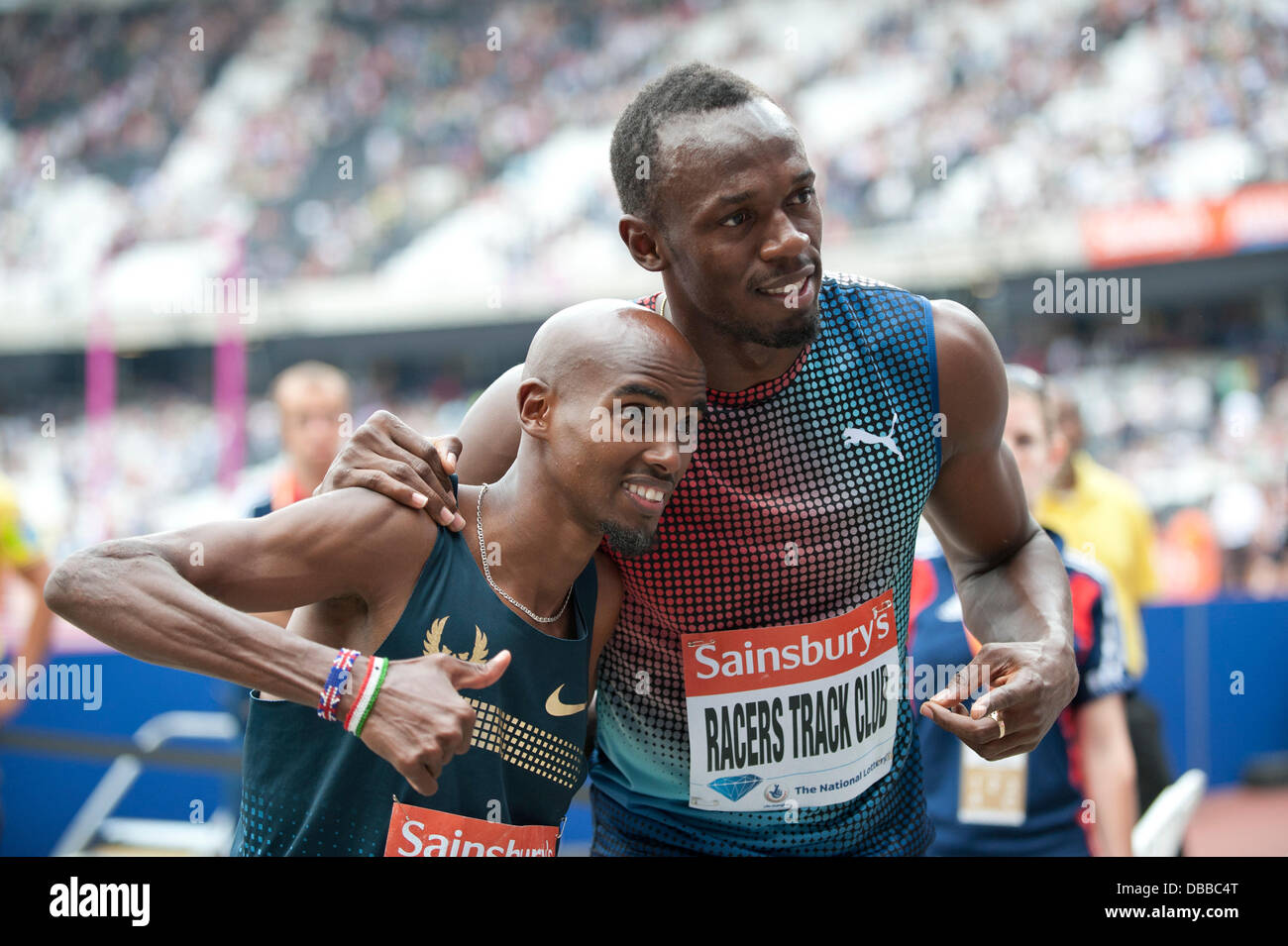 LONDON, UK. Saturday 27th July 2013. Double Olympic Champions Mo Farah and Usain Bolt pose for a photograph at the - Stock Image