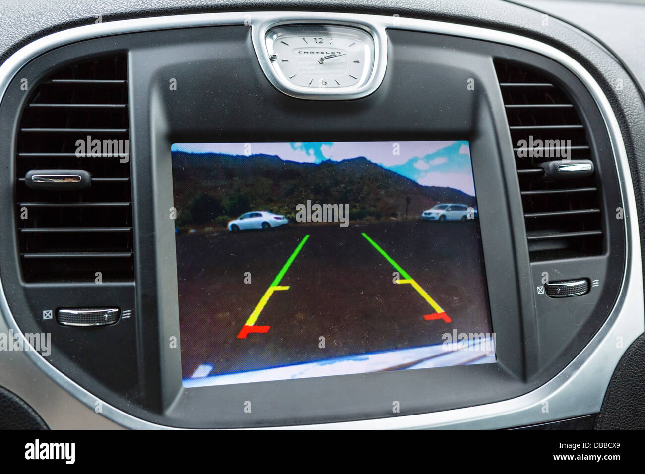 Dashboard screen showing image from Park View Rear Back-Up camera on a 2013 Chrysler 300C, USA - Stock Image