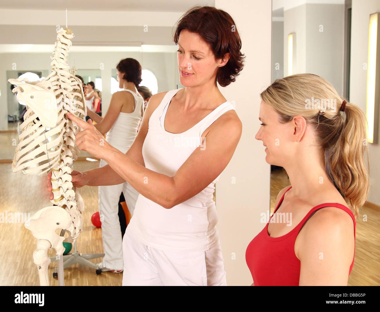 Physiotherapist explaining the spine - Stock Image