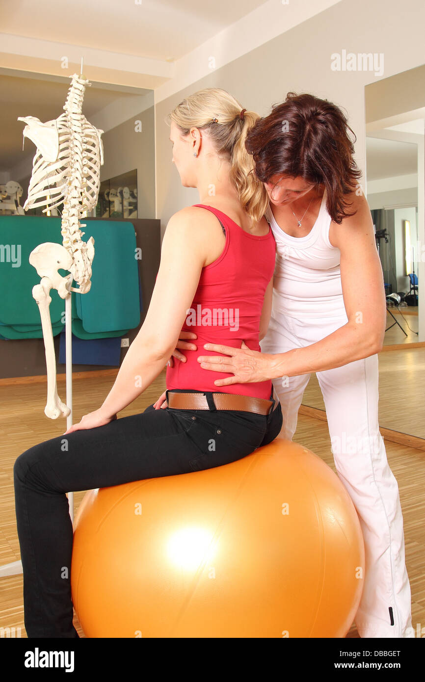 Physiotherapist with patient working on her Lumbar Spine - Stock Image