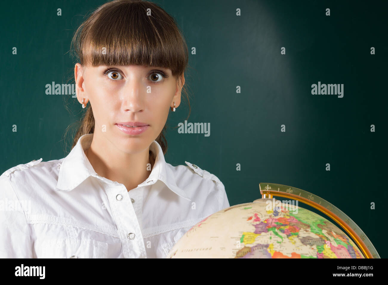 Surprised student look at the Globe - Stock Image