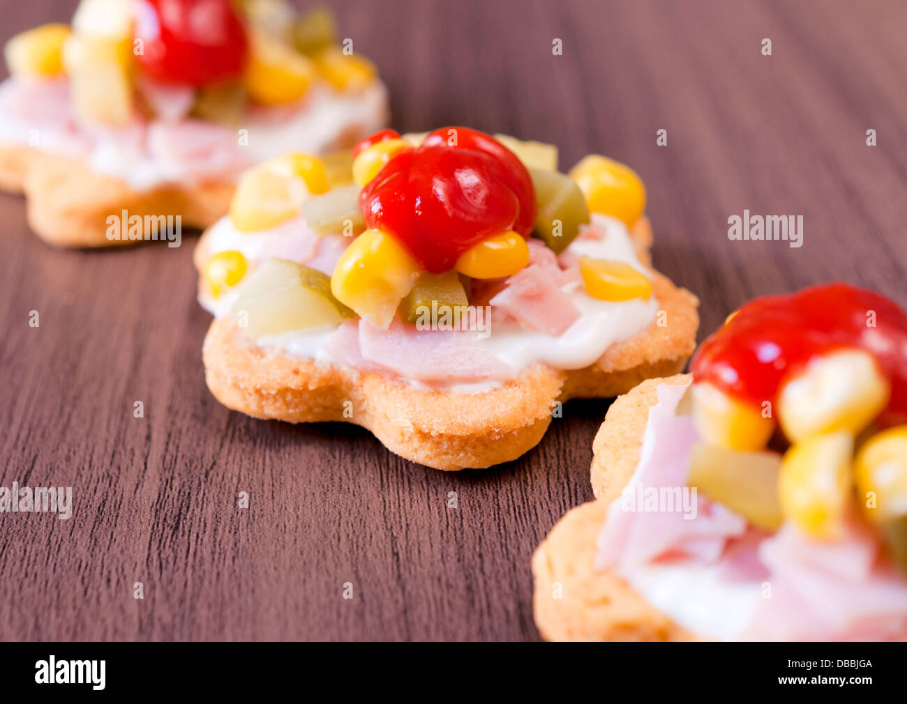 Selective focus on appetizer in the middle - Stock Image