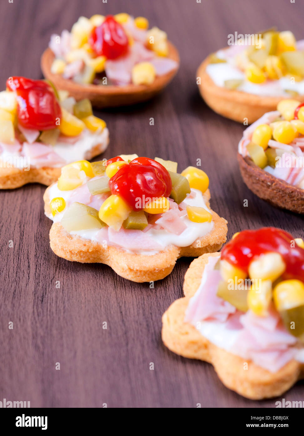 Selective focus on little snack in the middle - Stock Image