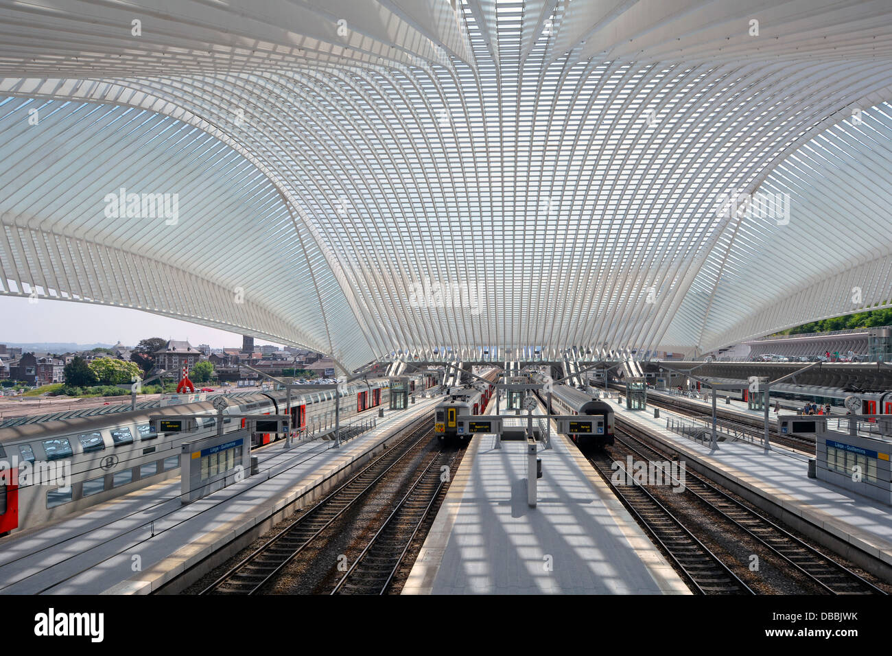 Railway tracks trains  platforms all covered by glass ceiling & roof in Belgium EU Liege modern architecture - Stock Image