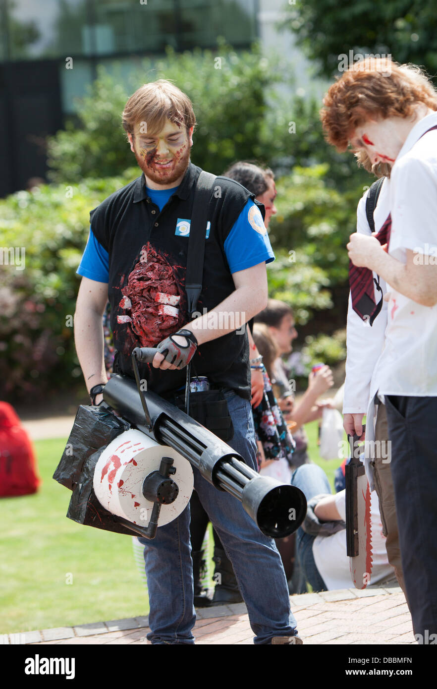 Birmingham, UK. 27th July, 2013. Tha annual Birmingham Zombie Walk takes plaace in Birmingham, UK. Pictured: Bringing - Stock Image