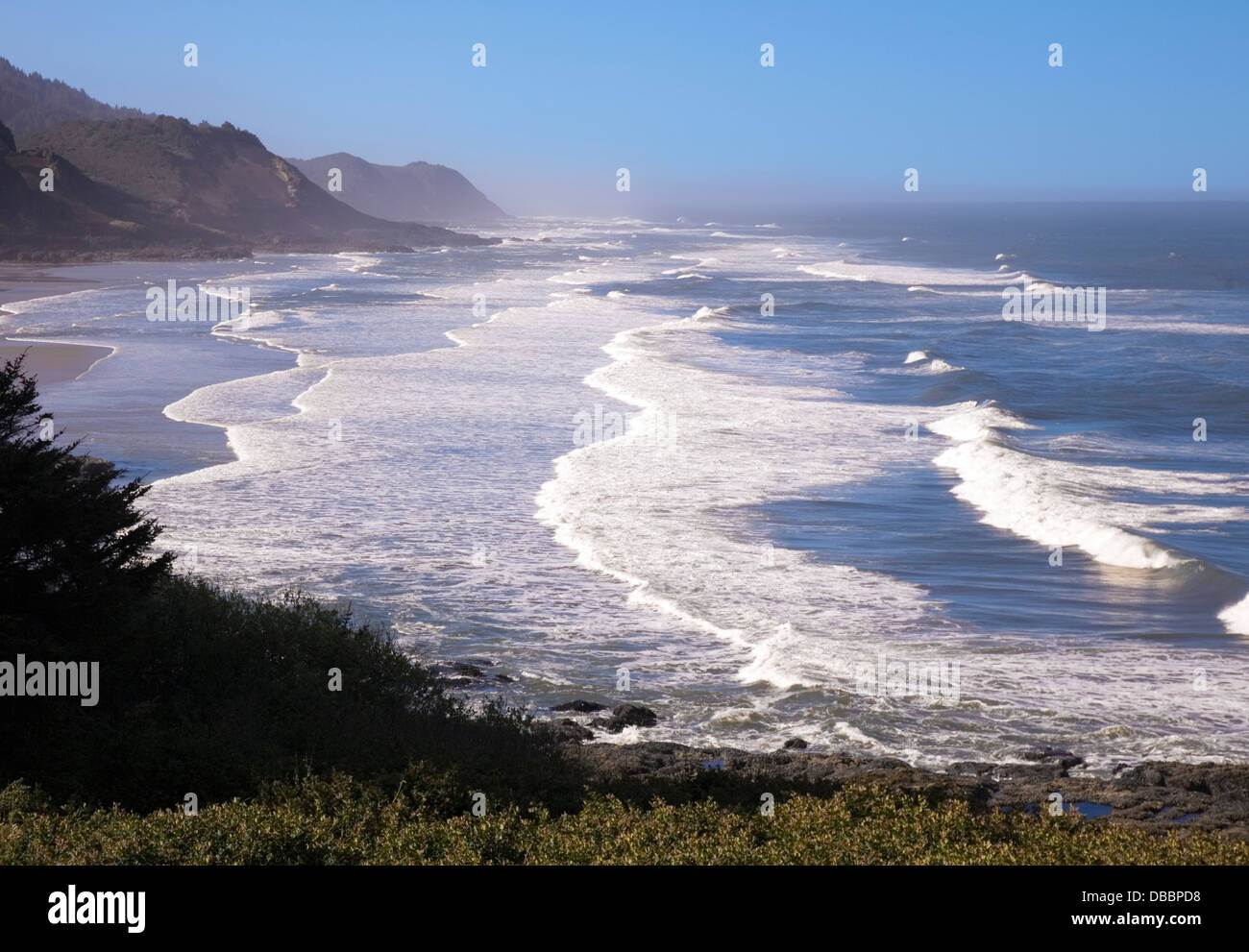 The coast of Oregon is a 363-mile long string of gorgeous beaches and rugged, brooding headlands fringed with forest, - Stock Image