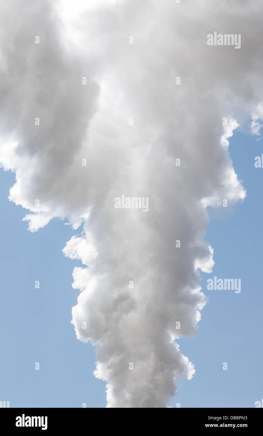 Massive amount of smoke rising up - Stock Image
