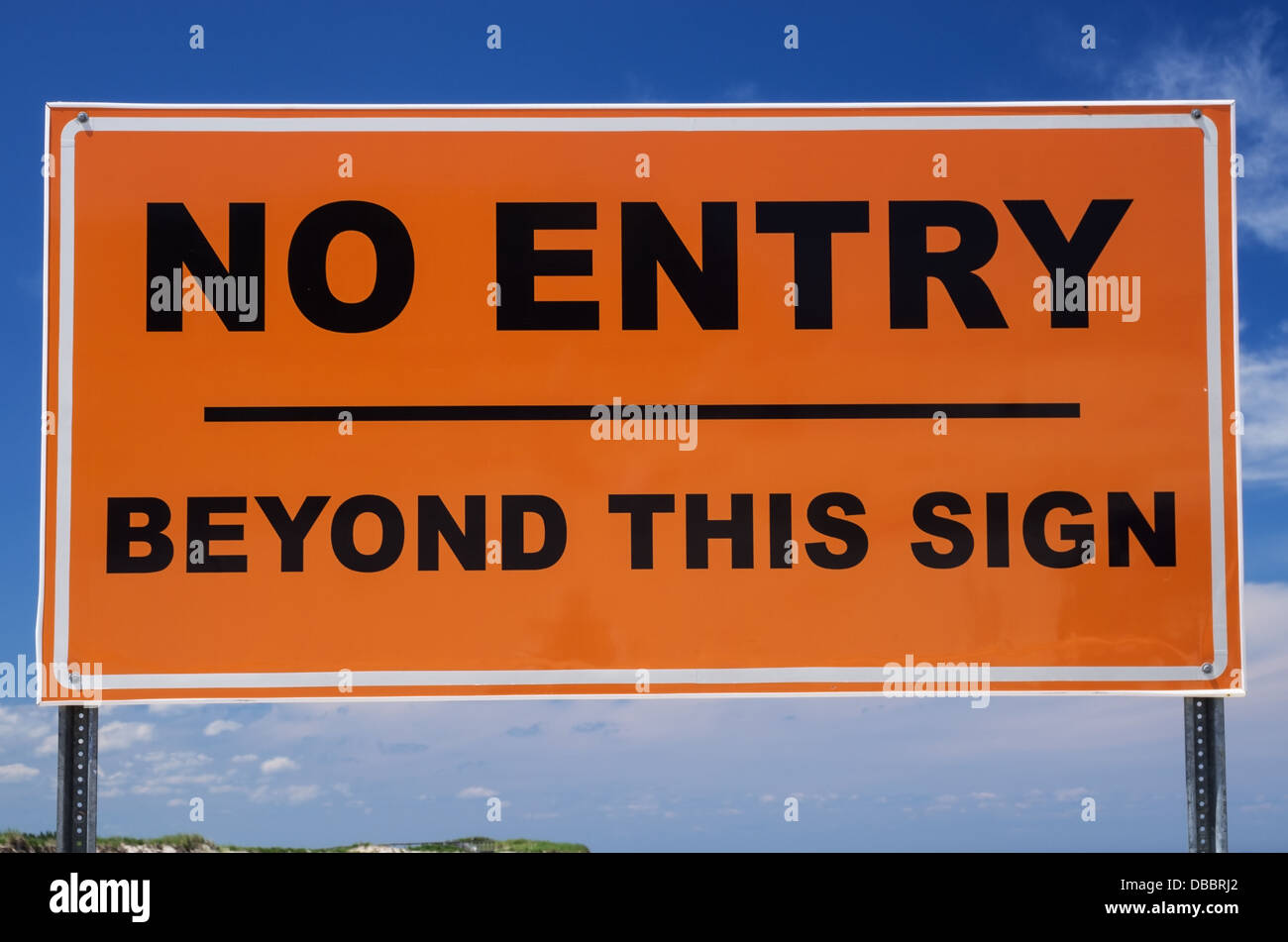 orange and black no entry beyond this sign sign - Stock Image