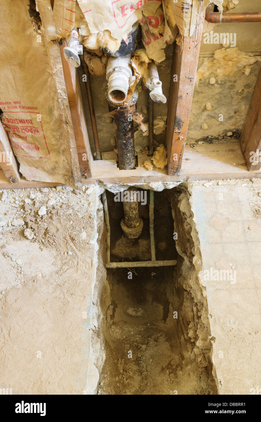 exposed water and drain pipes during home plumbing renovation - Stock Image
