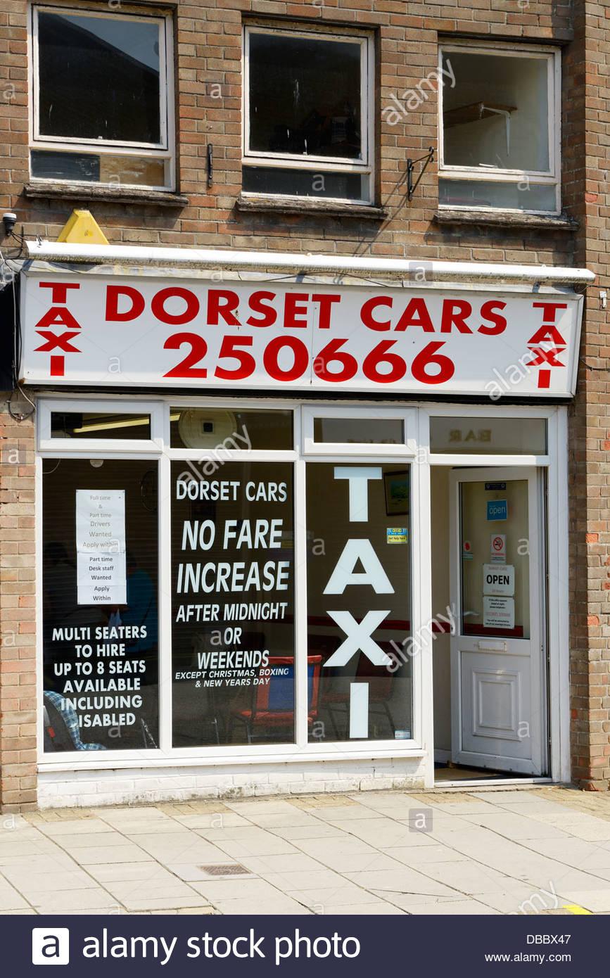 Dorset Cars mini cab office, Trinity Street, Dorchester, Dorset England UK Stock Photo