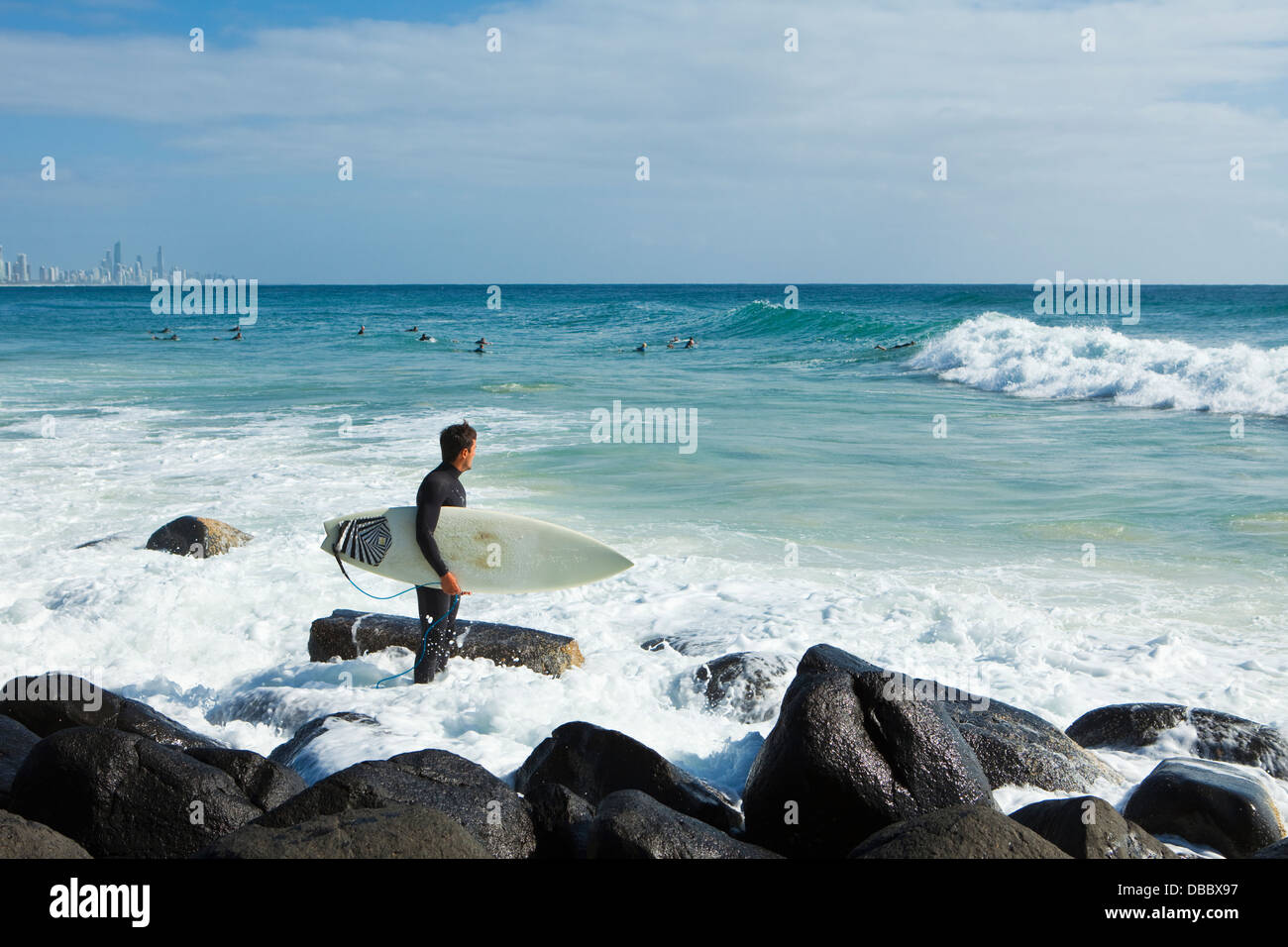 Surfer looking out to sea. Burleigh Heads, Gold Coast, Queensland, Australia - Stock Image