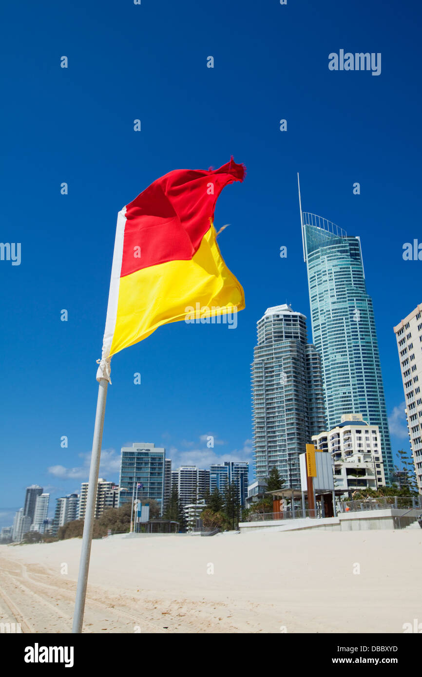 14120d61ce4 Surf lifesaving flag with city skyline in background. Surfers Stock ...