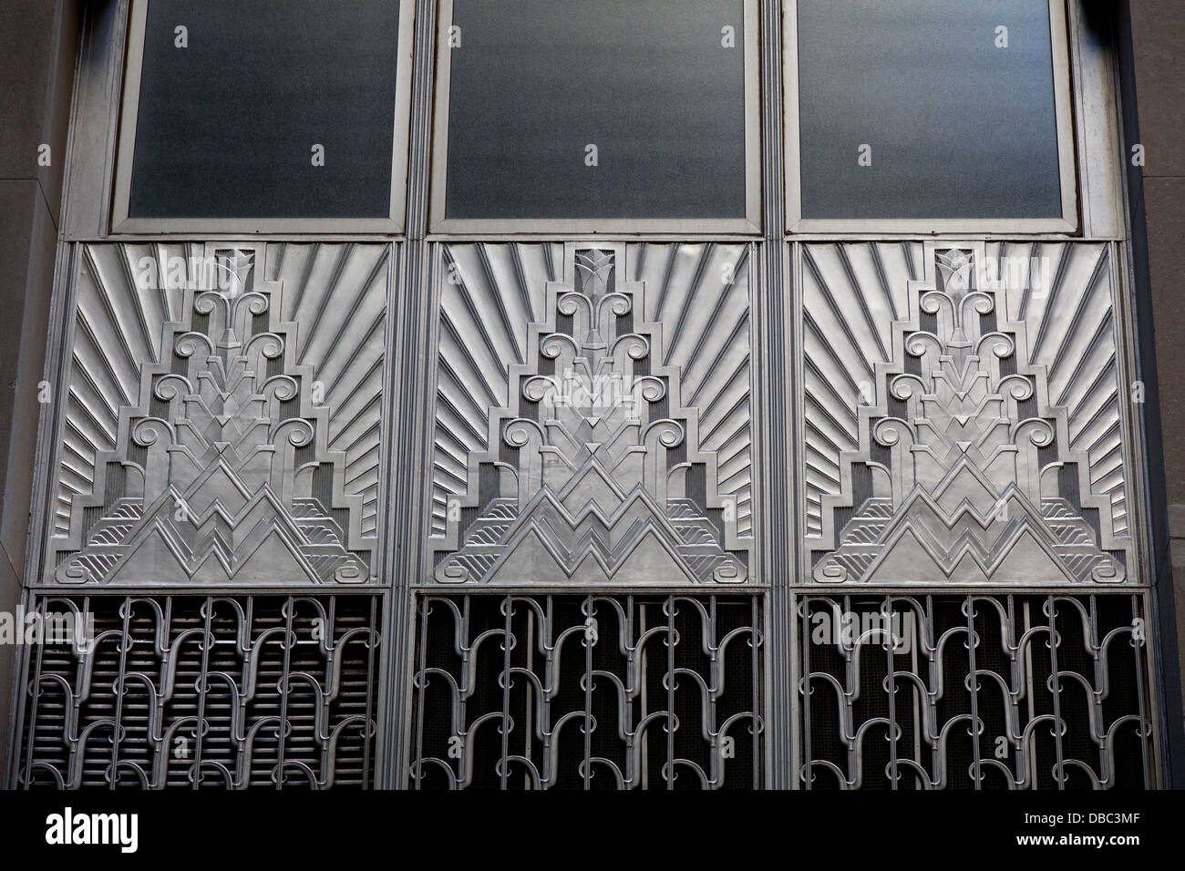 Bronze doors on the exterior of 20 Exchange Place in the Financial District in New York in Art Deco style - Stock Image