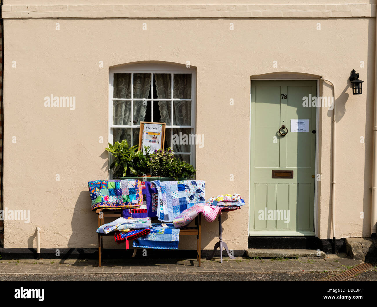 Textiles for sale in aid of  charity on display outside a house in Lavenham - Stock Image