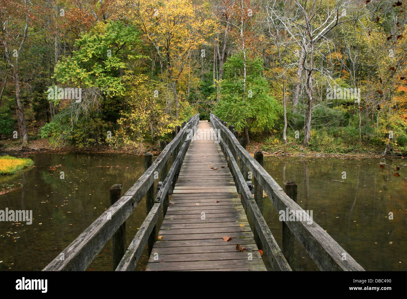 A Wooden Foot Bridge Over The Little Miami River In Autumn John