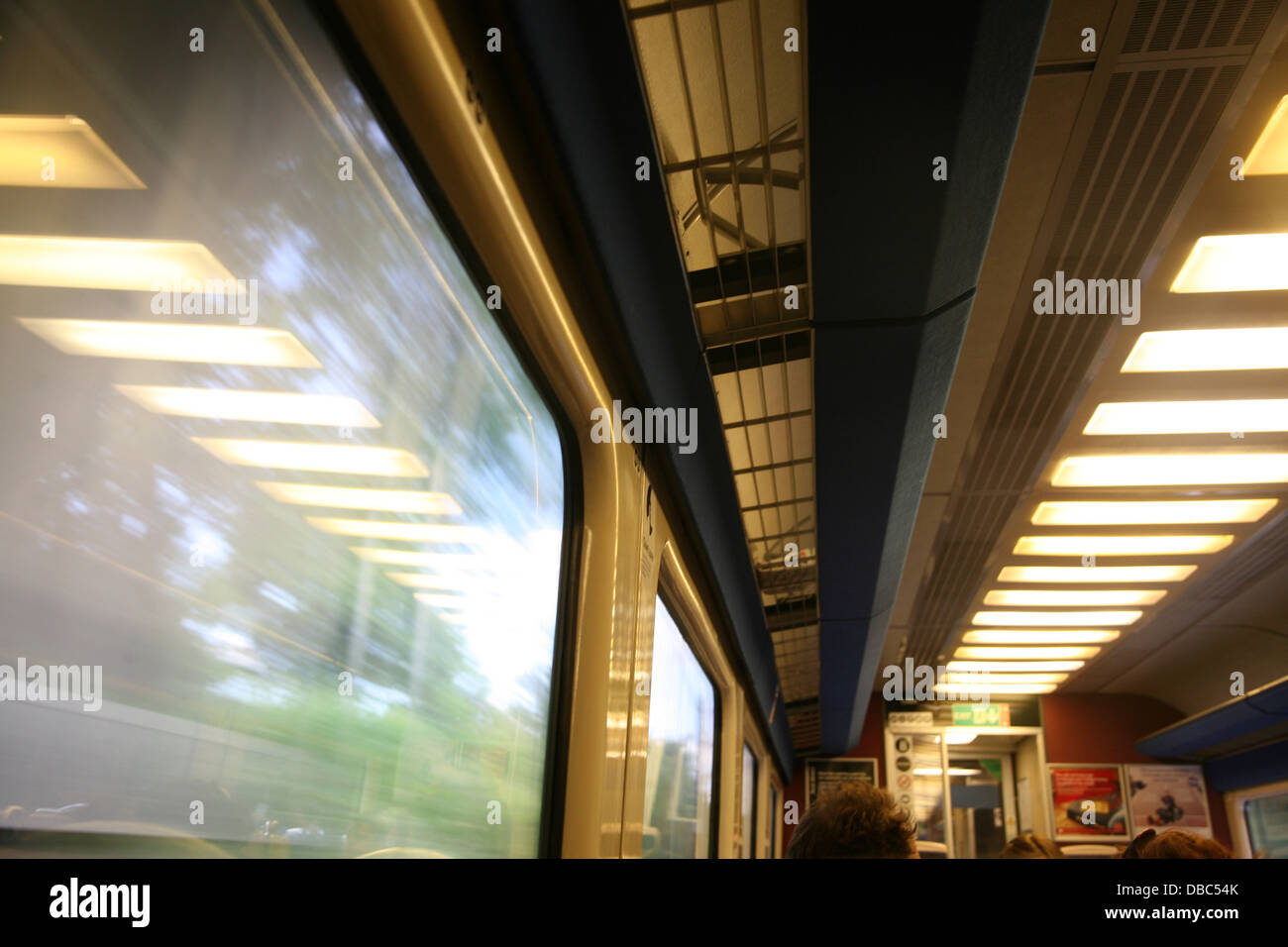 Lights blurred motion train carriage travelling high speed - Stock Image