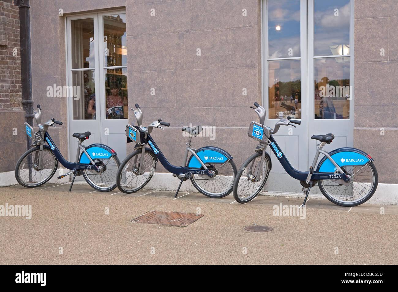 3 Boris bikes parked outside Kensington Palace in London Stock Photo