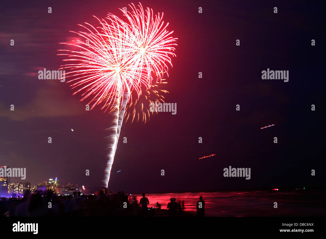Miami Beach Florida Fourth 4th of July fireworks display celebration public event burst night Atlantic Ocean shoreline - Stock Image