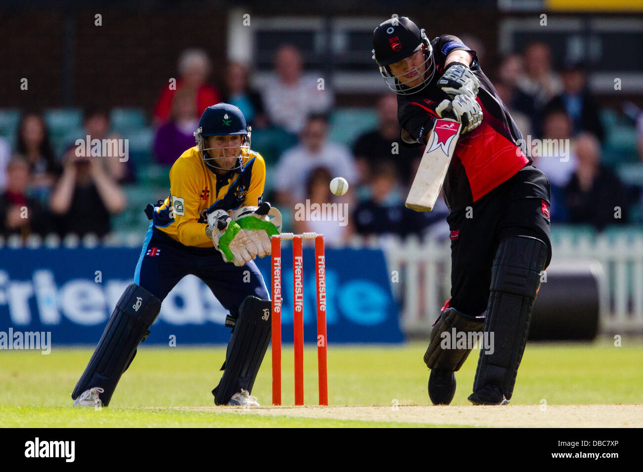 Leicester, UK. Sunday 28th July 2013.  Leicestershire's Josh Cobb (right) hits out as Yorkshire's Dan Hodgson - Stock Image
