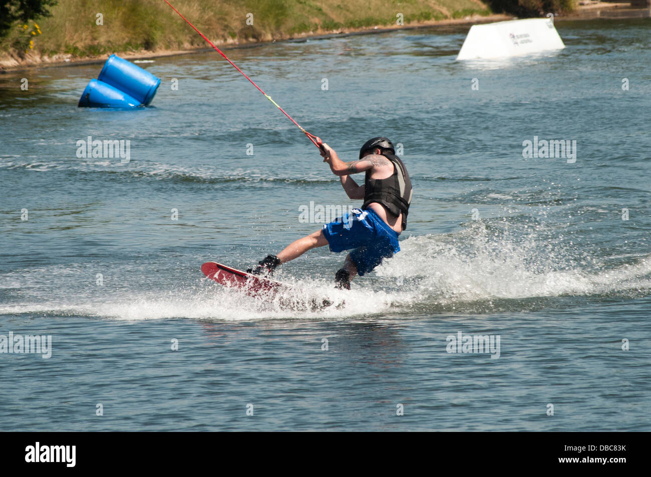 man wakeboarding on a lake - Stock Image