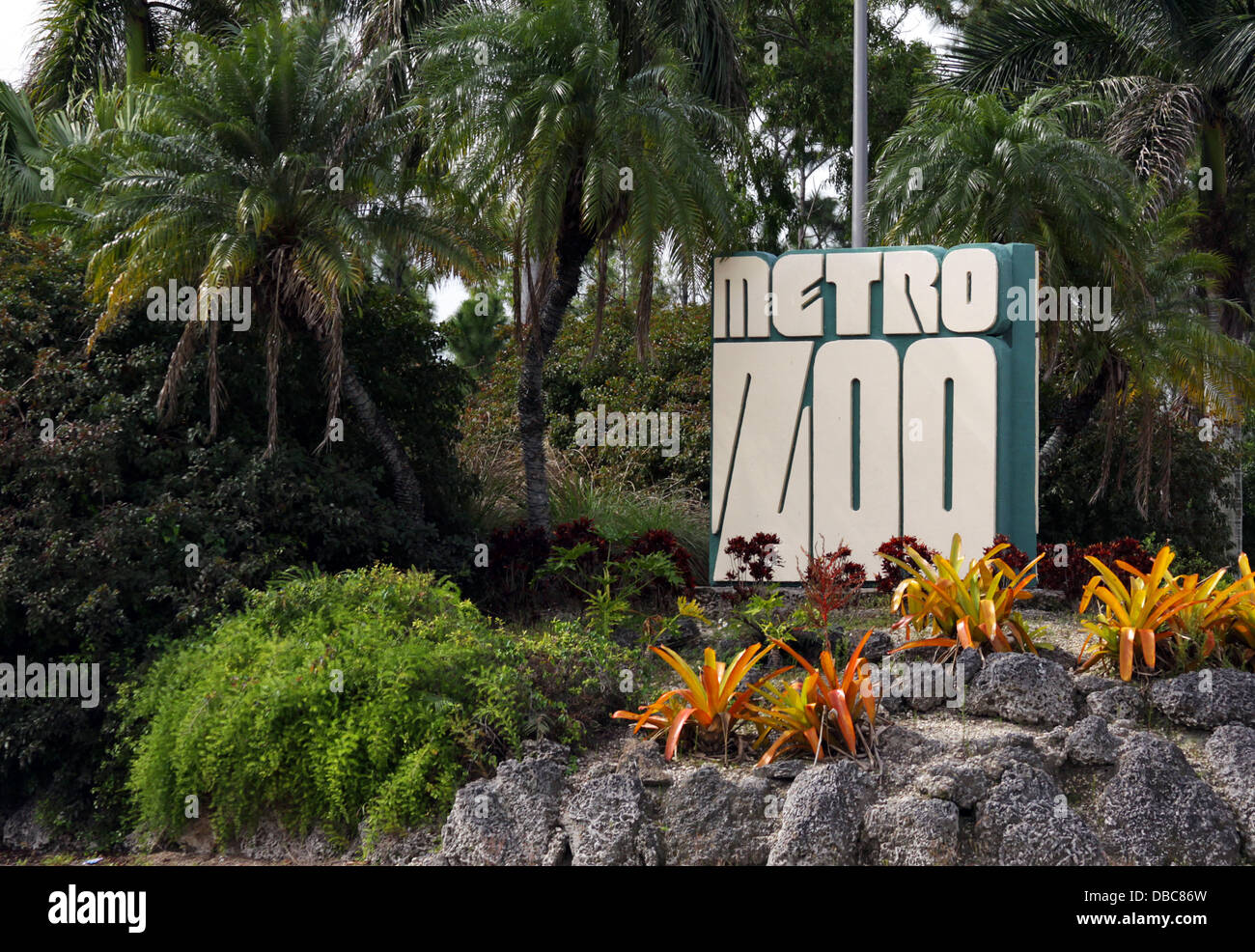 Miami Metro Zoo welcome sign at the entrance with some landscaping.  Located in Dade County it is a major attraction - Stock Image
