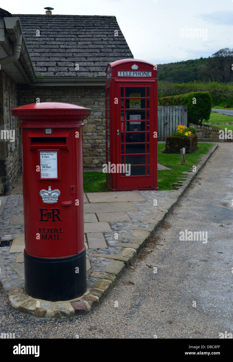 Red Post Box & Telephone Kiosk in the Village of Bolton Abbey on the Dales Way Long Distance Footpath Wharfedale - Stock Image