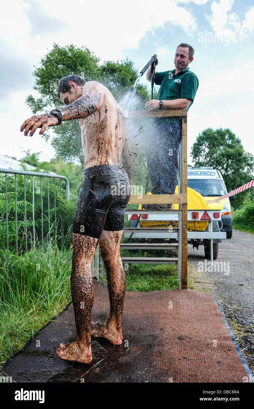Dungannon, Northern Ireland, 28th July 2013 - A male competitor is hosed down after swimming at the 2013 Northern - Stock Image