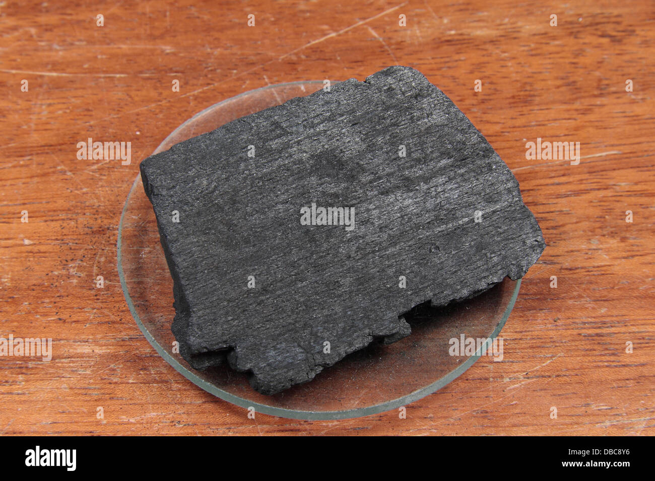 A charcoal block, as used in a UK high school. - Stock Image