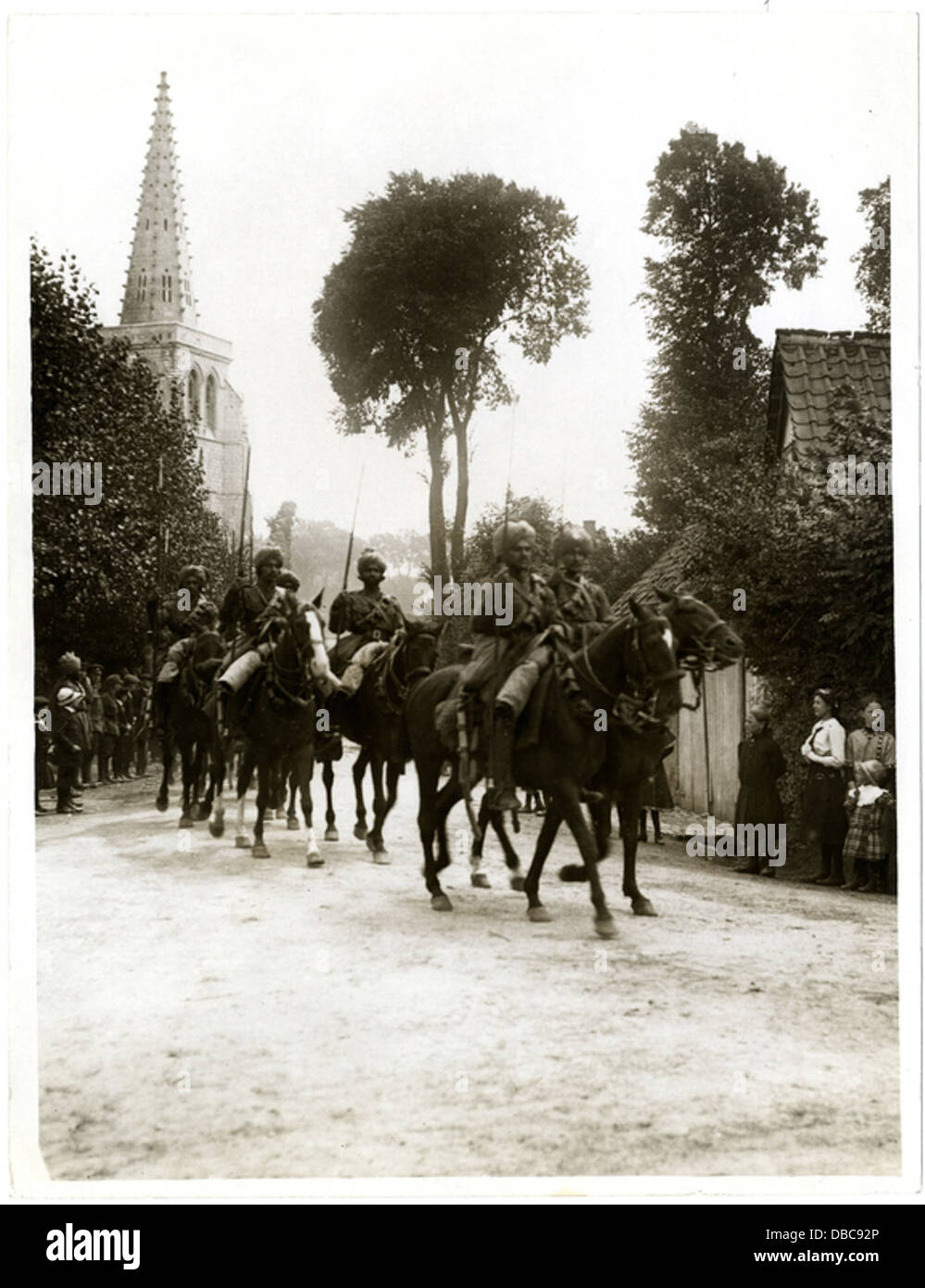 Indian cavalry marching through a French village Estr C3 A9e Blanche (Photo 24-115) - Stock Image