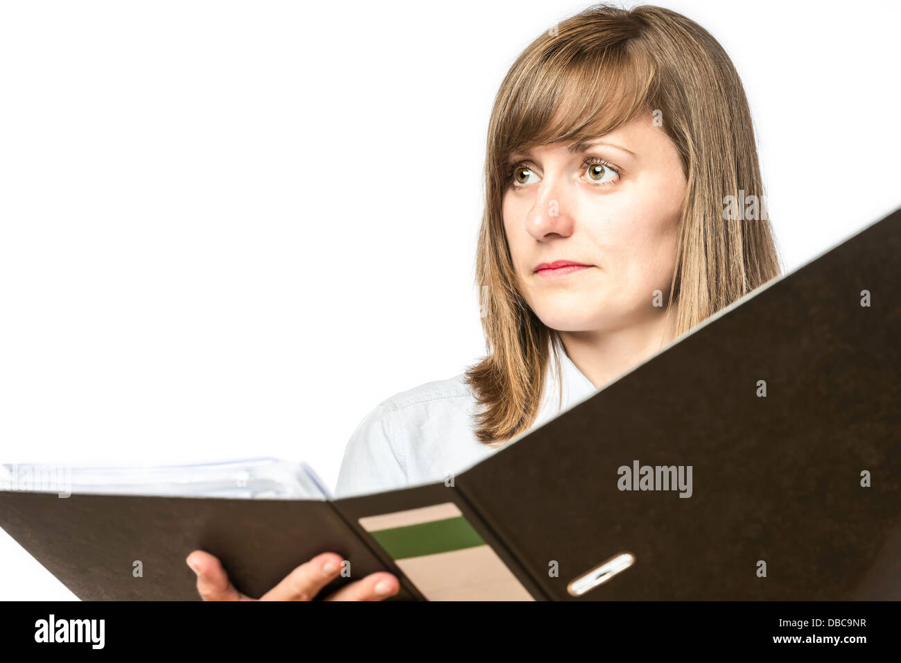 Young woman holding an open file folder, isolated on white background - Stock Image
