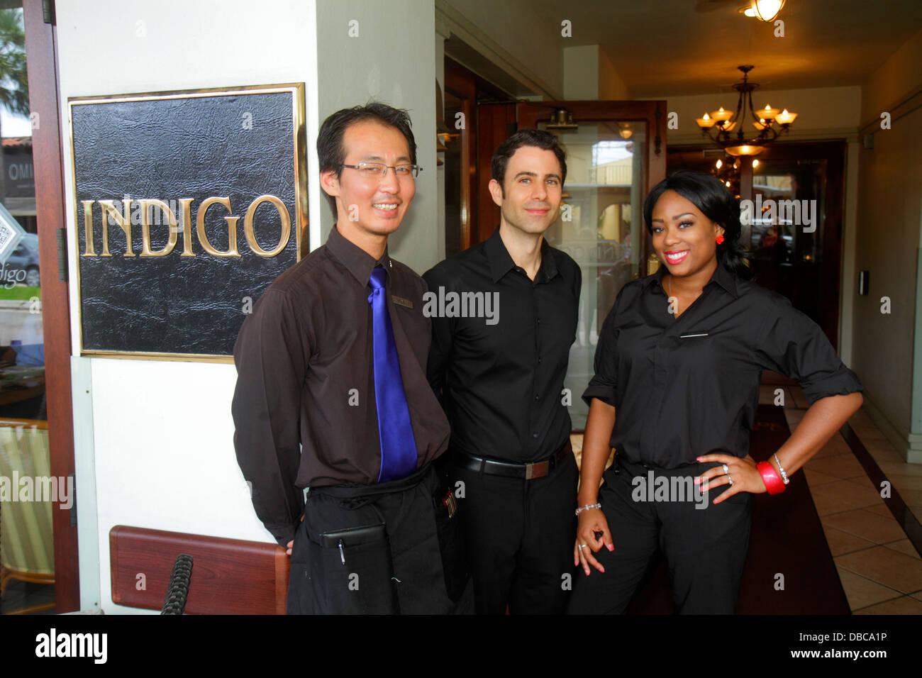 Fort Lauderdale Ft. Florida Las Olas Boulevard businesses shopping Riverside Hotel Indigo restaurant waiter host - Stock Image