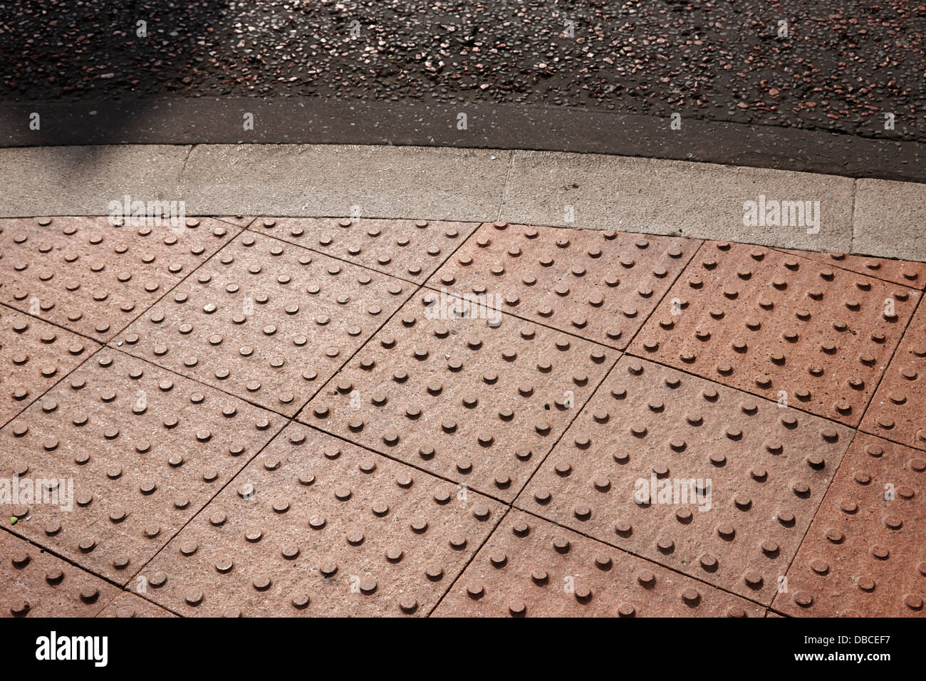 truncated dome tiles tactile pavement as a disability aid in the uk - Stock Image