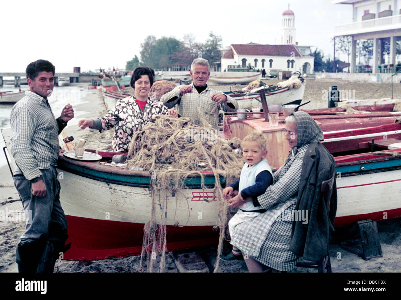 fishermen and their family have coffee on the beach near Barcelona circa 1969 - 1970 - Stock Image