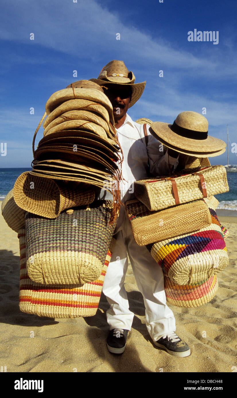 50a55422abe36 Local Mexican beach vendor selling straw hats and bags to tourists in Cabo  San Lucas Baja California Mexico