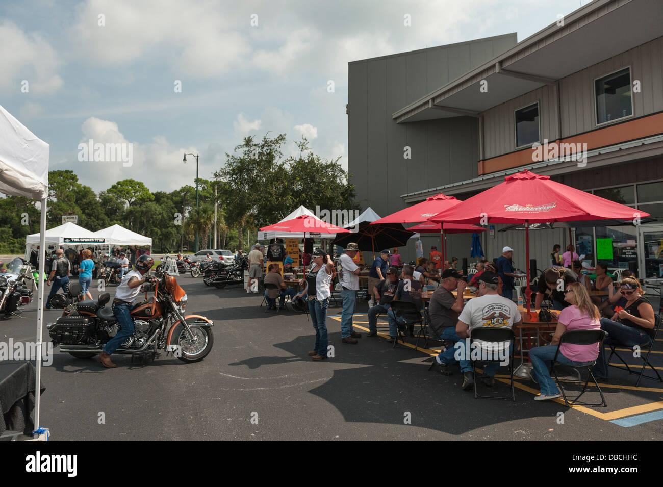 People enjoying some food while attending the Gator Harley-Davidson