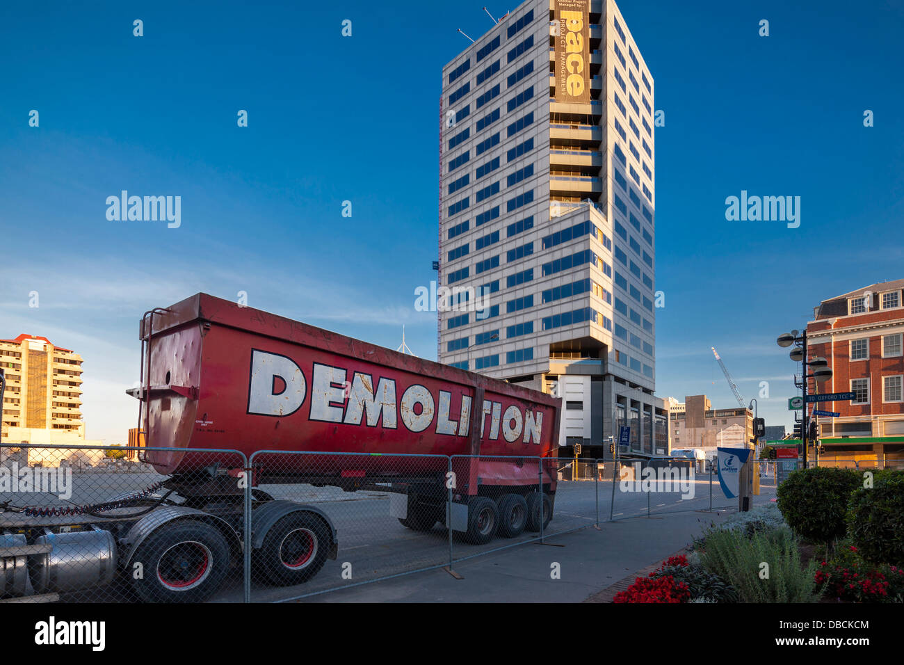 Forsyth Barr Building, 764 Colombo St, Christchurch, New Zealand with demolition truck and fence; cordon. - Stock Image