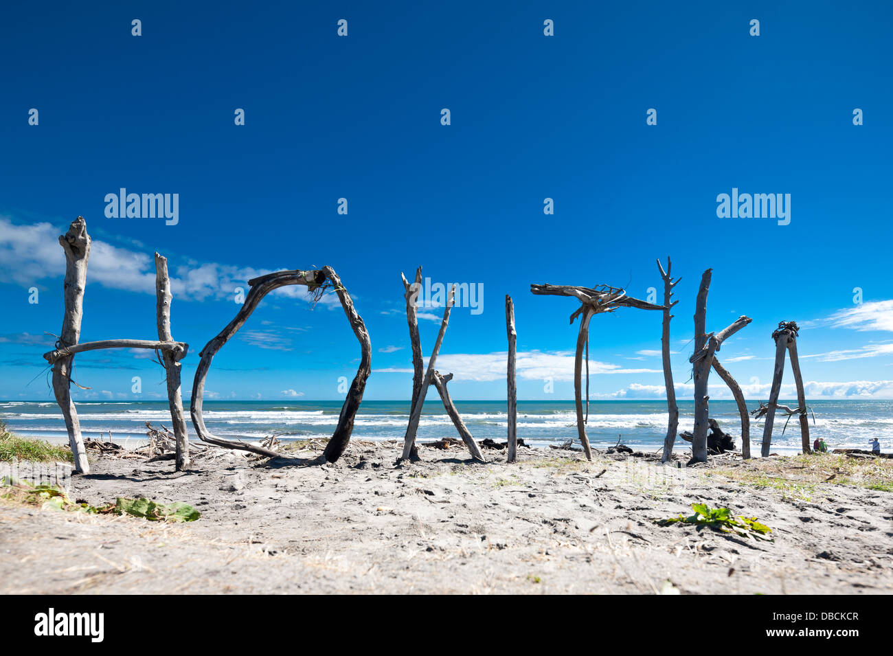 Hokitika. Driftwood sculpture; town name sign sculpted from found drift wood on Hokitika Beach, South Island, New - Stock Image