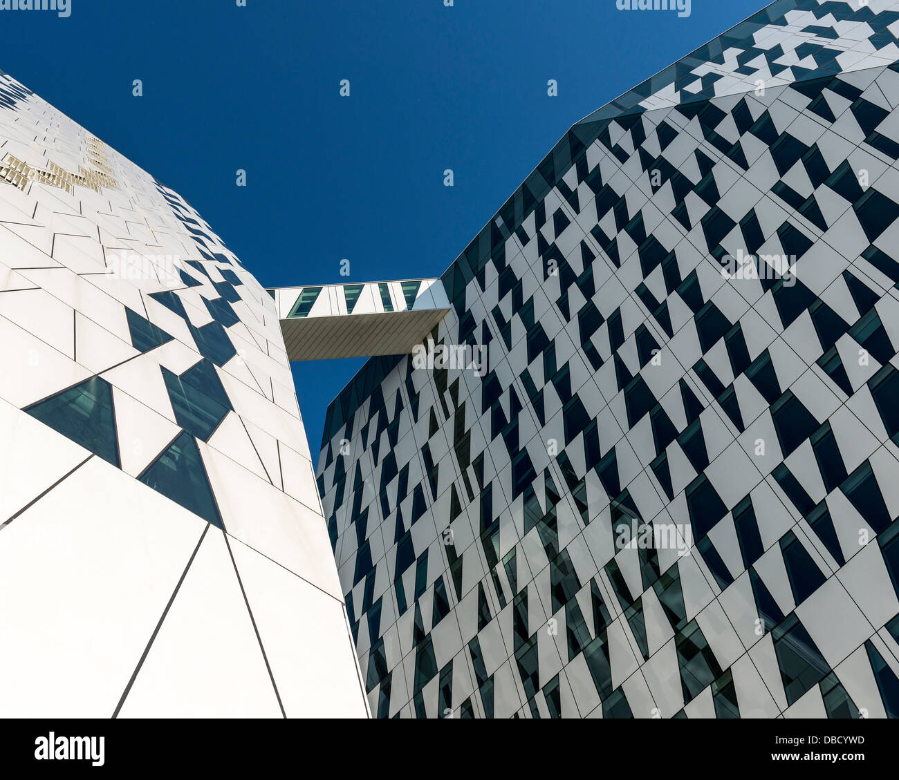 Bella Sky Hotel, Copenhagen, Denmark. Architect: 3XN, 2011. View of both towers and sky bridge from below. Stock Photo
