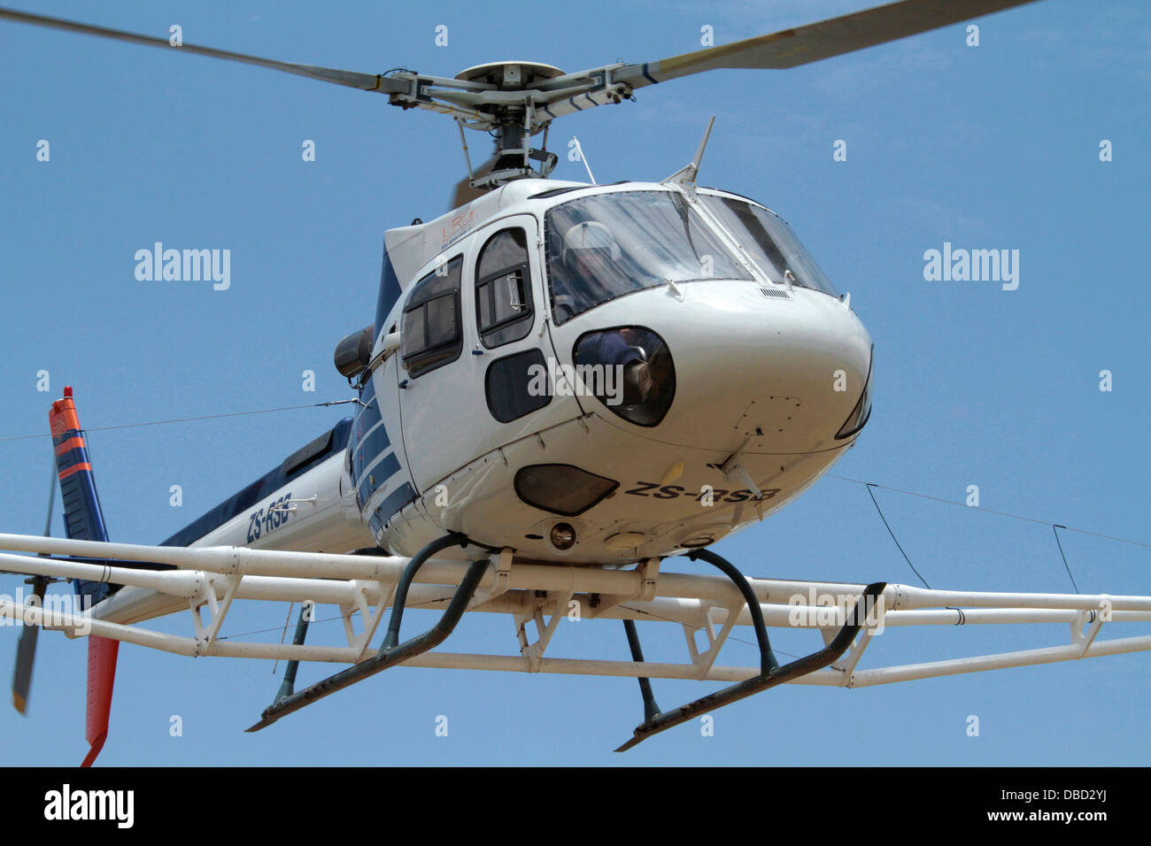 A Squirrel jet engined helicopter on a Geophys Survey for Minerals - Stock Image