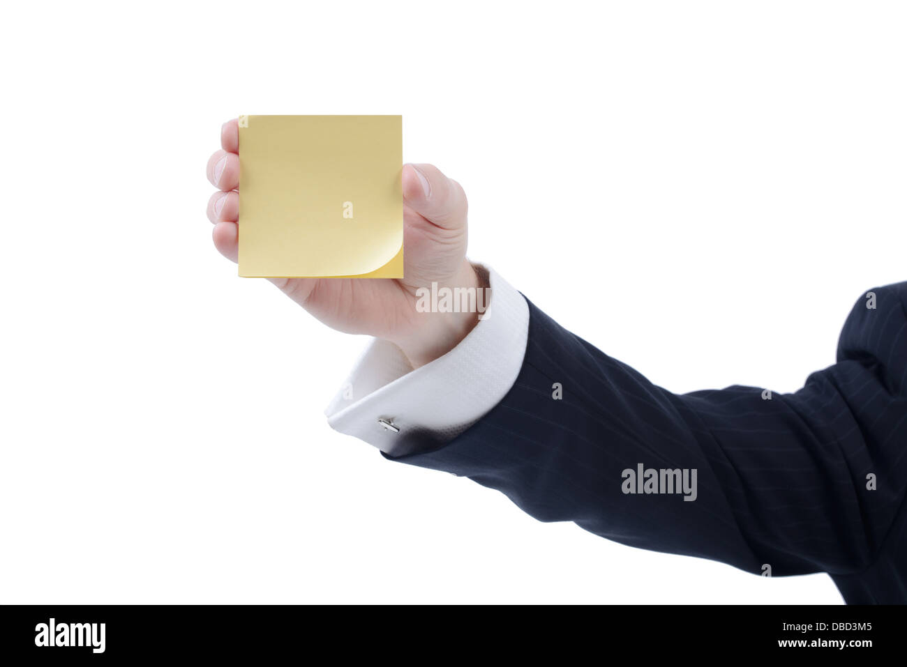 businessman holding a yellow stick reminder note isolated on white background - Stock Image