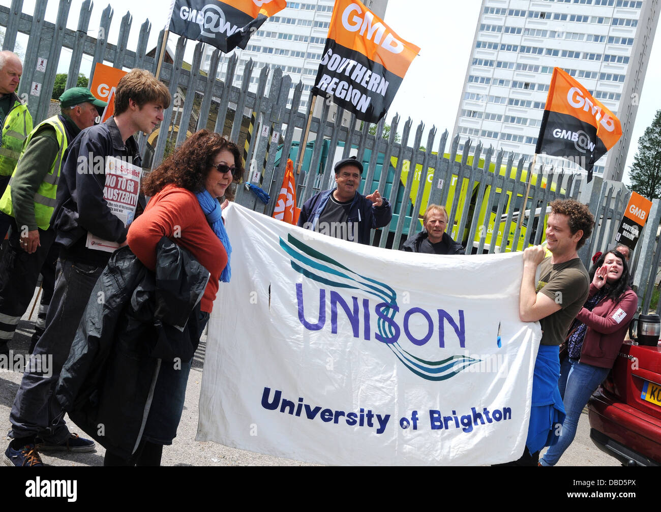 Trade Union Unison shows solidarity with striking GMB workers in Brighton during a protest over proposed pay cuts. - Stock Image
