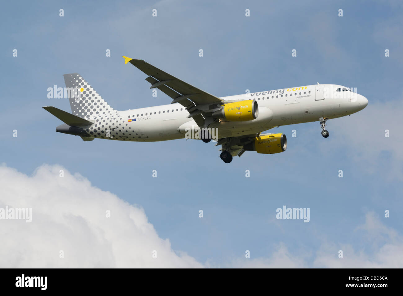 Vueling Airlines Airbus A320-200 on final approach - Stock Image