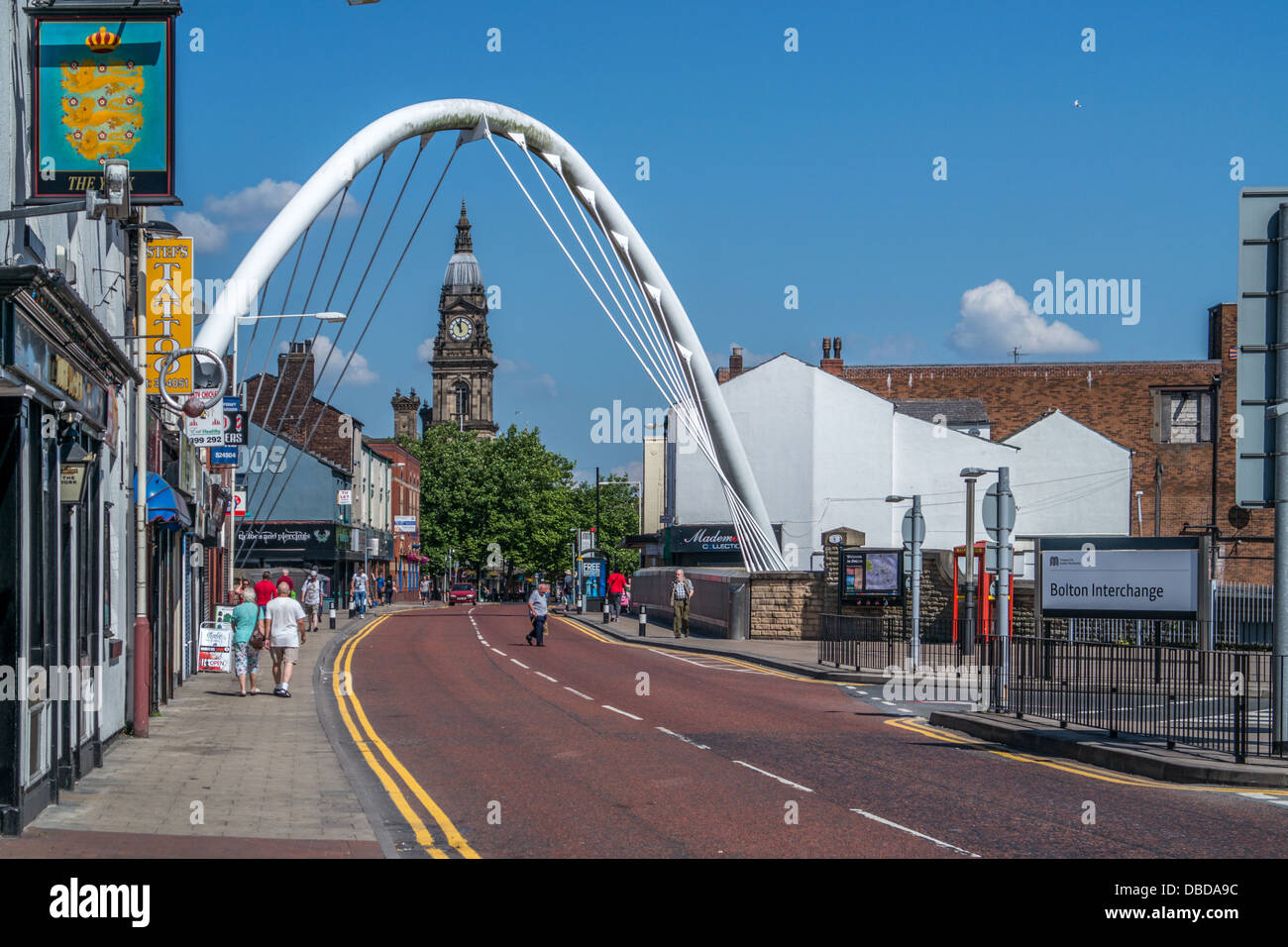 looking along the road under the archway towards Bolton Town hall, Bolton Town Center, - Stock Image