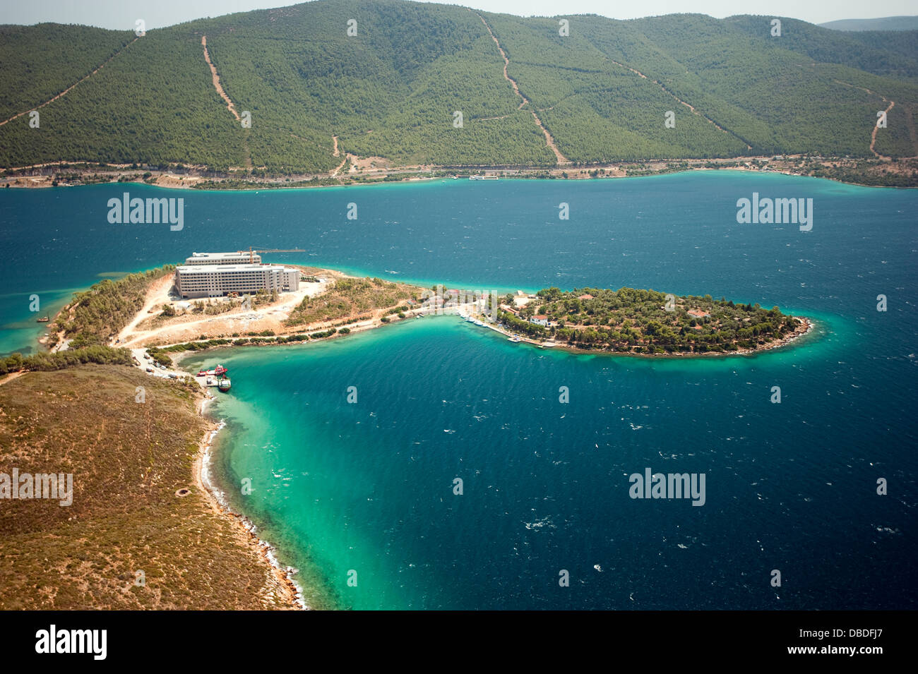 Aerial view of coastal development hotel construction and environmental impact in Güllük Bay Bodrum Turkey - Stock Image