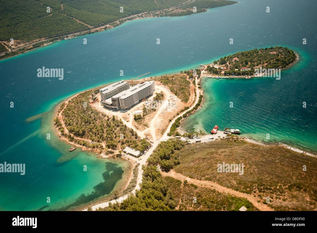 Aerial view of coastal development hotel contruction and environmental impact in Güllük Bay Bodrum Turkey - Stock Image