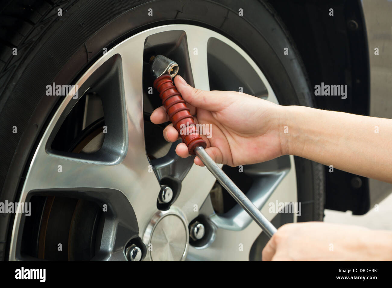 How To Put Air In Car Tires >> Hand Fill Air Into A Car Tire Stock Photo 58691687 Alamy