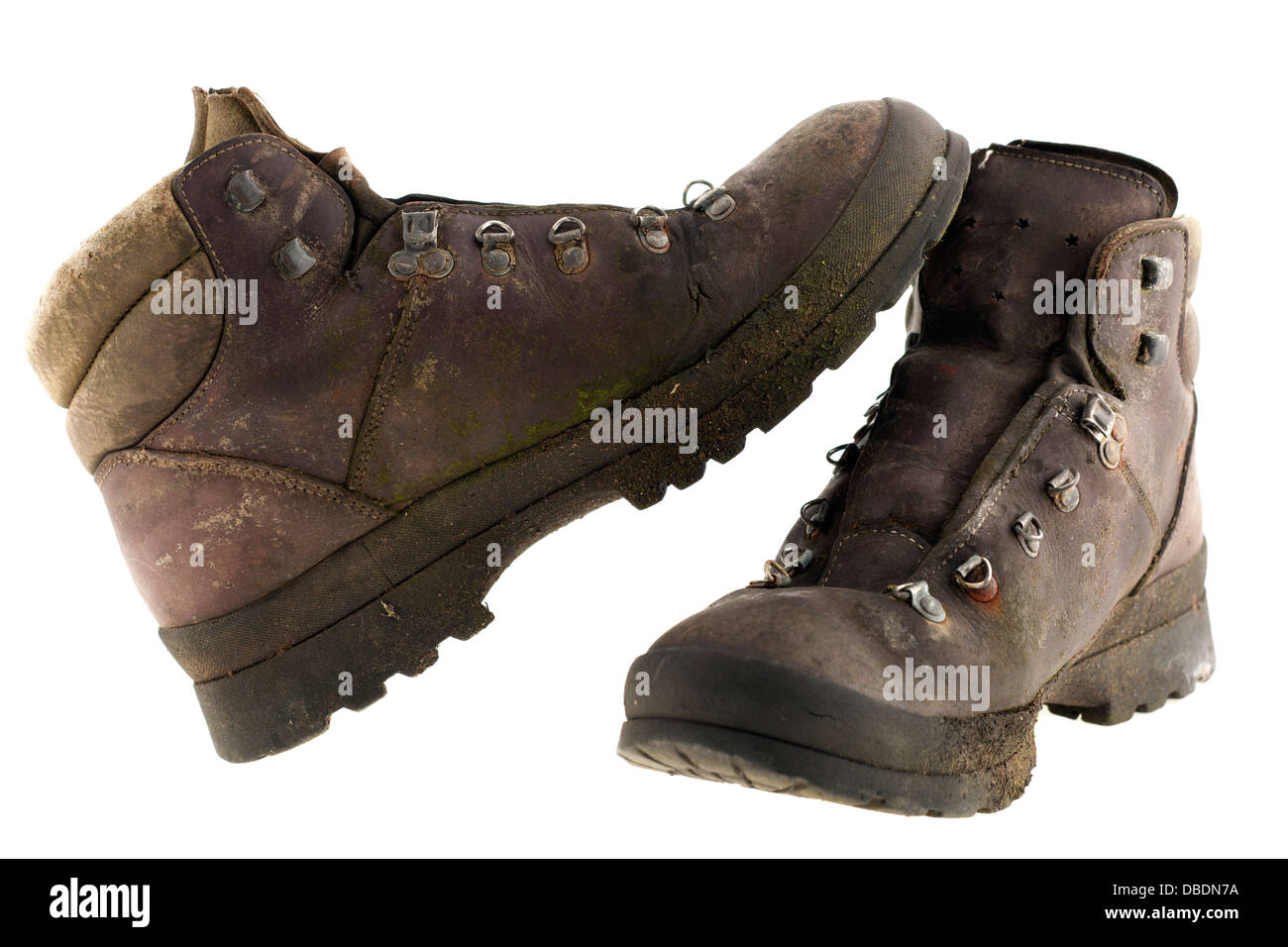 Pair of unlaced worn out weathered brown leather walking boots - Stock Image