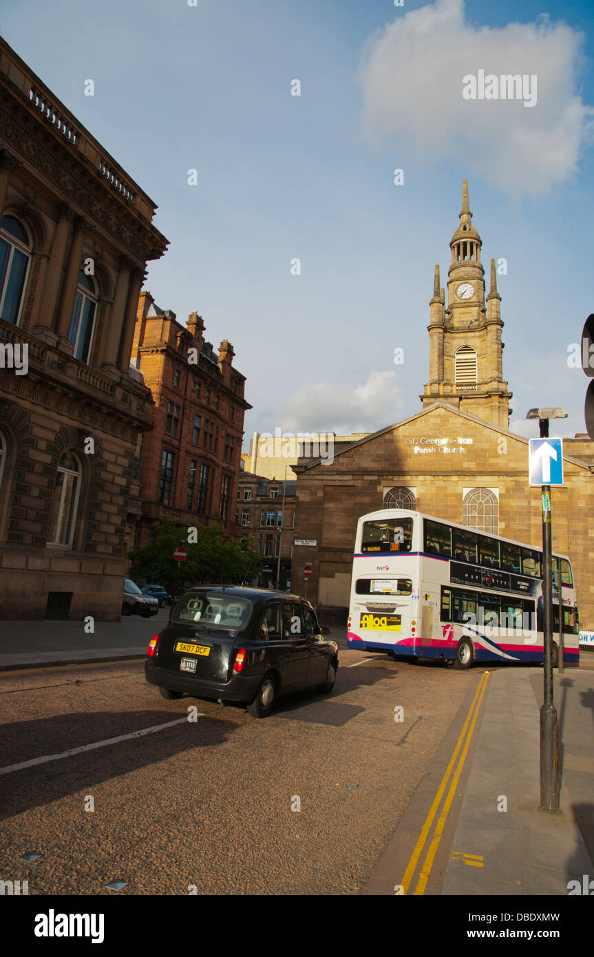 Traffic going past The Tron Church along Bath street and Nelson Mandela square central Glasgow Scotland Britain - Stock Image