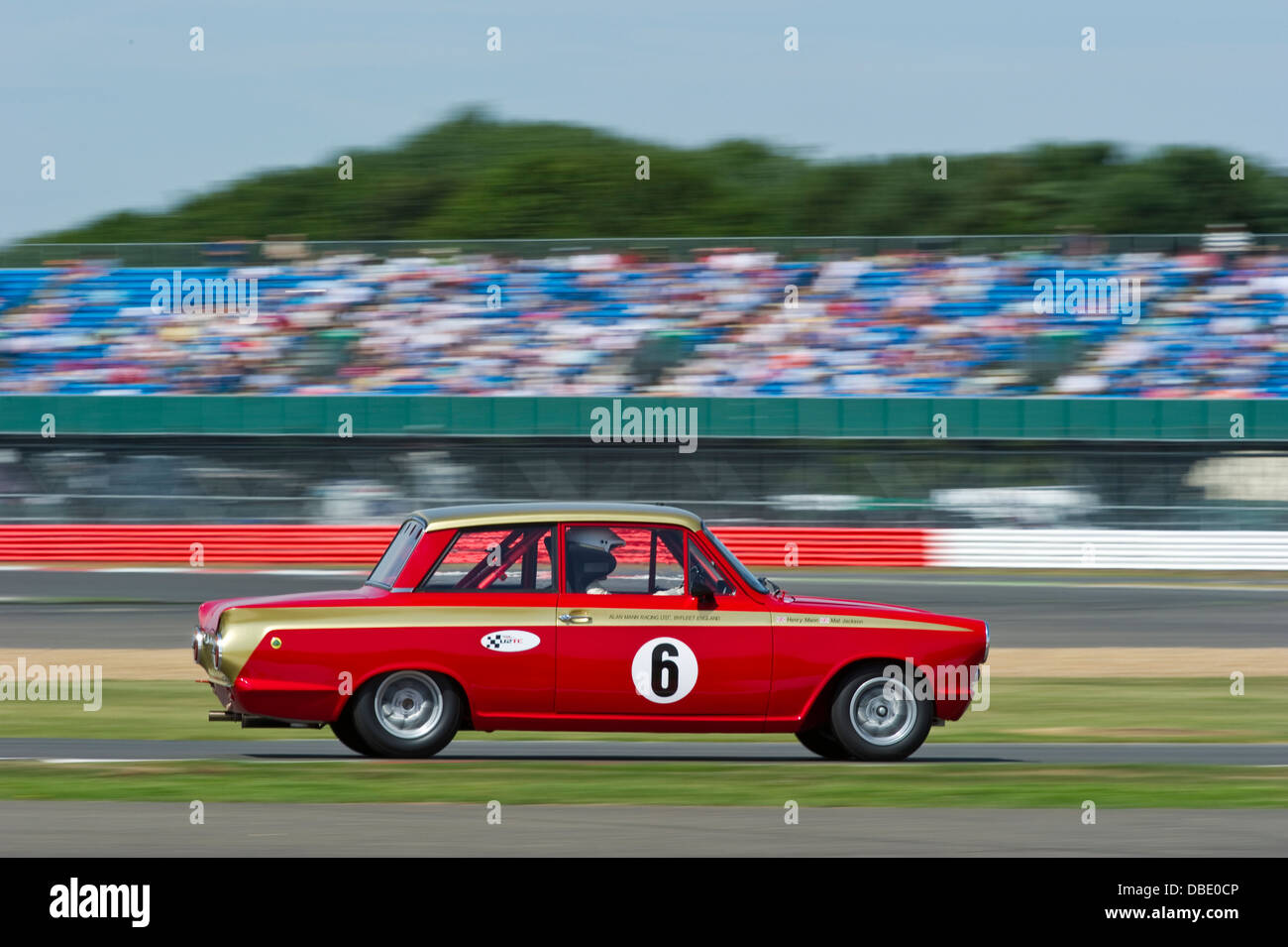 Henry Mann & Anthony Reid in a Ford Lotus Cortina during the 2013 Silverstone Classic Under 2 Litre Touring - Stock Image