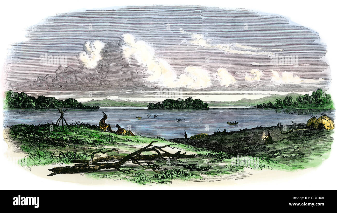 Native American's camp beside Sandy Lake, Minnesota, 1850s. Hand-colored woodcut - Stock Image